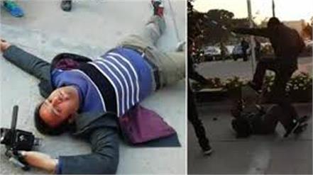 tv cameraman injured beaten by nawaz  s security gaurd