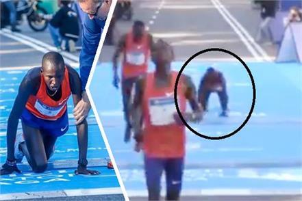 marathon runner collapses and crawls over finish line in malaga marathon