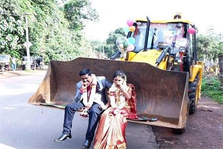 the groom brought the bride in jcb