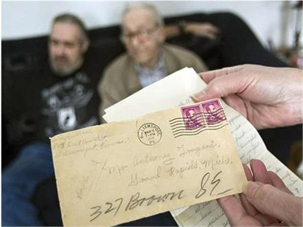 man discovering letter from hidden by his wife about son