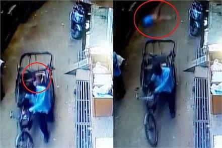 a child fell from a building on a rickshaw that was passing on road below
