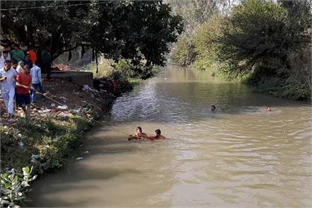 three children drowned in the canal two rescued search for third continues