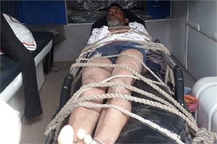 lying the patient on a stretcher and tied it with ropes