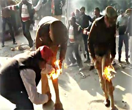 sp workers fired cm yogi s effigy fire in clothes of the guards