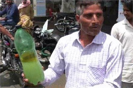 people protest about adulteration of water in petrol