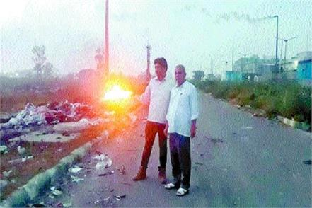 factory operators burning garbage in open large industrial area