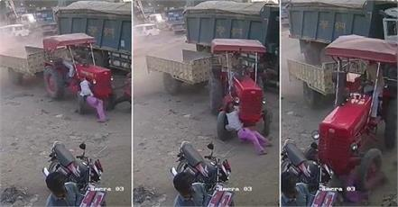 the tractor descended from the road thrashing three people cctv