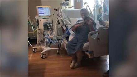 covid patient in icu plays violin for hospital staff