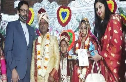 up dm suddenly arrives at the wedding of martyr bsf jawan s daughter
