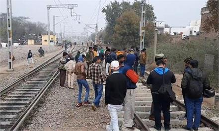 dead body of youth found hanging from tree near railway track
