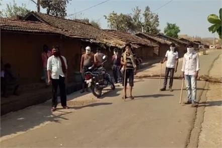 the villagers blockade with wooden poles