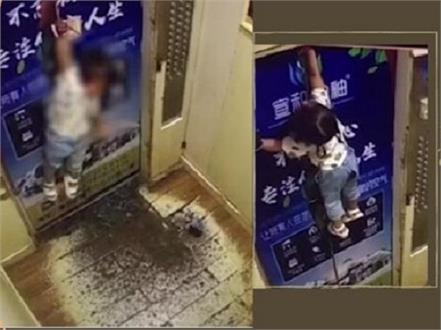 china toddler gets dragged hangs mid air in elevator