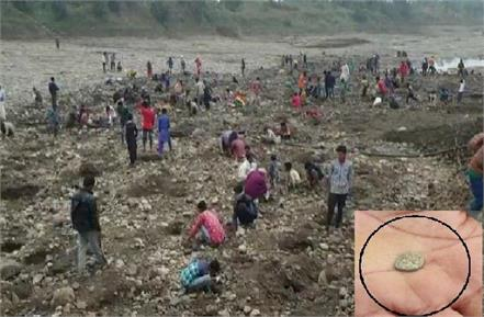 gold and silver coins coming out of the river in rajgarh