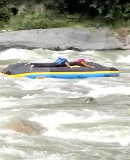 four tourists were doing rafting suddenly the raft overturned