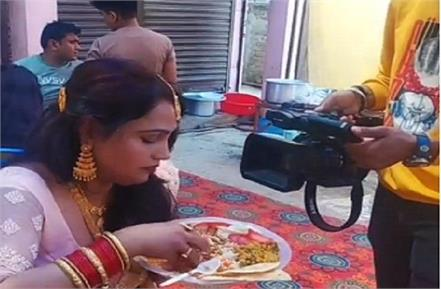 the woman was eating food at the wedding video viral