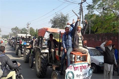 tractor march by farmers on opposing tax on oil and farming machines