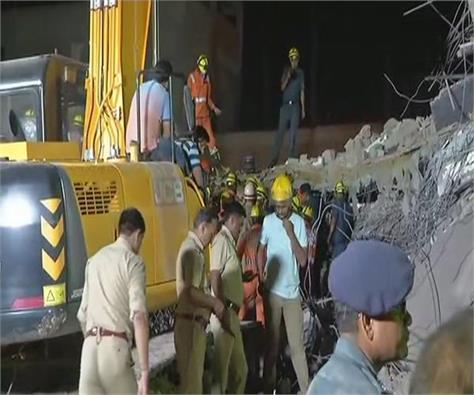 9 dead in greater noida building collapse rescue operations continue