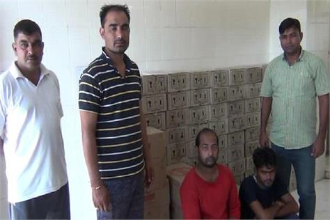 100 bags of liquor seized from up palwal two drivers arrested
