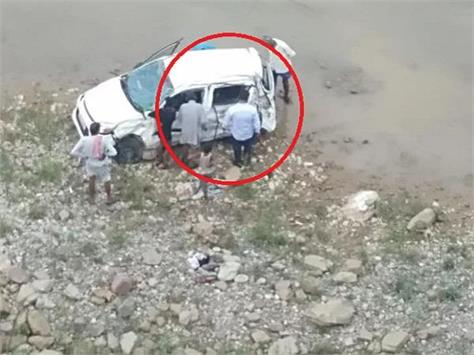 painful incident car returning from a procession fell into a deep ditch