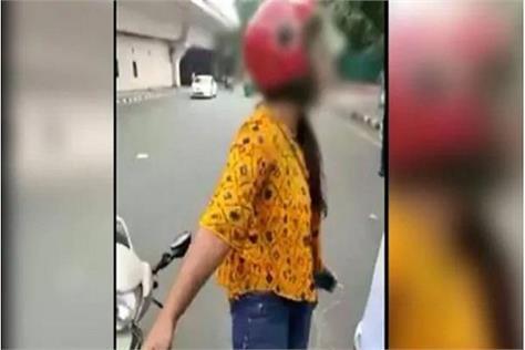 girl high voltage drama in delhi threat of suicide after challan